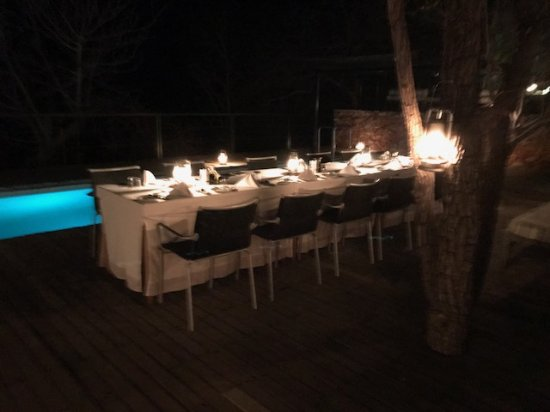 The Outpost: Our dining table by the pool
