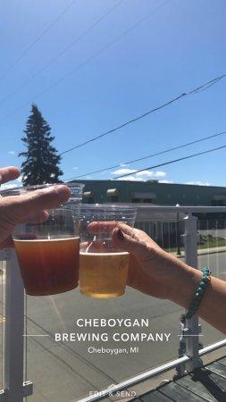 Cheboygan, MI: Beautiful day, woman, and beer