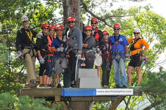 Charlemont, MA: Our ziplining group high in the canopy, with guides H.B., left, and Alisha, right.