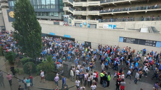 The Croke Park: Gaelic football supporters leaving Croke Park Stadium. We heard next to nothing through the wind