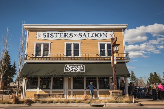 Street view of the iconic Sisters Saloon & Ranch Grill