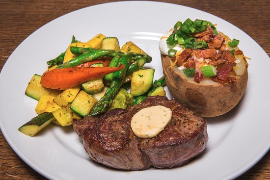 Sisters, OR: one of our beautiful fillets with a loaded baked potato and veggies