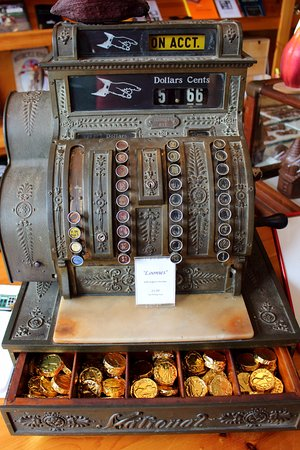 Victoria, Canada: old fashioned cash register with chocolate coins