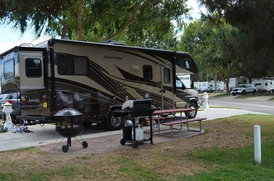 Flying Flags RV Resort & Campground: Our super premium pull thru site with bench, bbq, and fire pit.