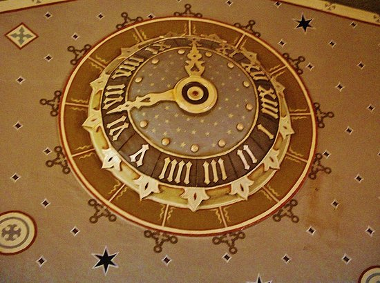 McMenamins: Clock art decor up at top of south wall.