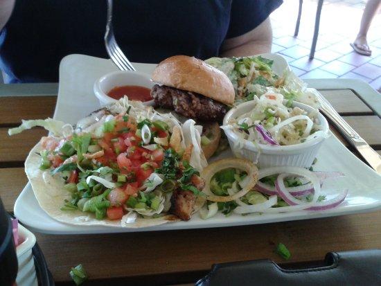 Sunshine Grill: One fish taco, one slider, slaw and caesar salad.
