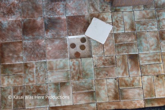 Dixon, Илинойс: President Reagan hid coins under this tile as a child