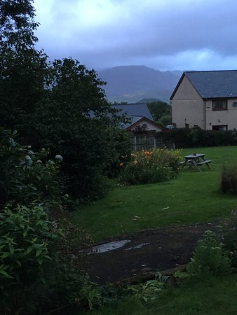 Llan Ffestiniog, UK: View from our room with back garden of hotel and mountains in the distance.