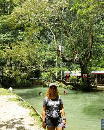 Tham Phu Kham Cave and Blue Lagoon : You can see the tree behind me, that is the highlight of this place. You can climb up and then j
