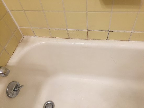 Norwich, VT: Moldy grout and tiles about to fall out in tub area