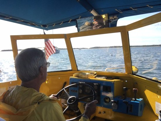 Hyannis, MA: View of the Capt Piloting the boat