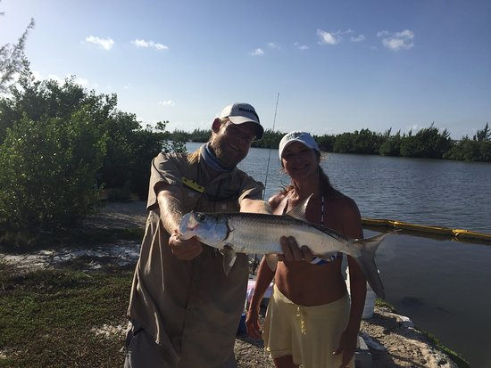 George Town, Grand Cayman: Her 1st Tarpon She schooled everyone on the Tarpon for 2 days