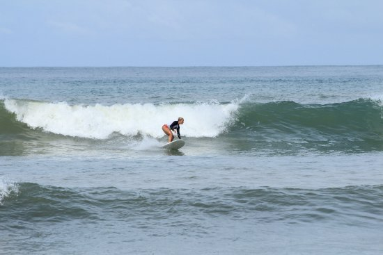 surfing playa dominicalito with photos by Jeanine