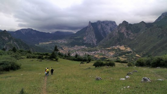 Diebu County, China: The loop trail ends at Fairy Meadow above the village. 30 minutes to the parking lot.