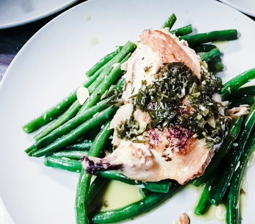 Chicken breast skin-on with green beans and herb jus