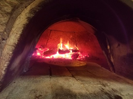 Carroll, IA: Pizza being fired in our brick oven!