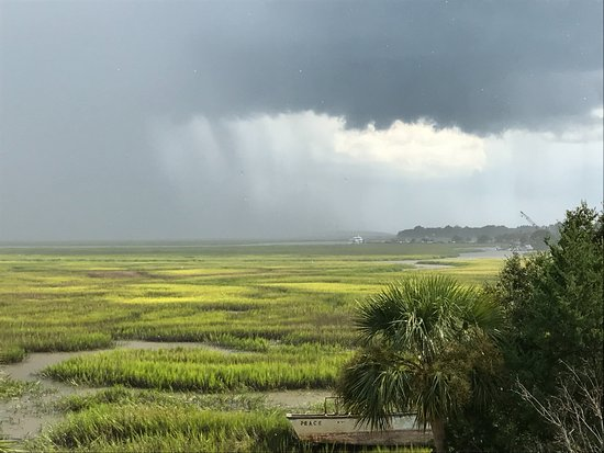 Darien, GA: View from our room of a thunderstorm over the marsh