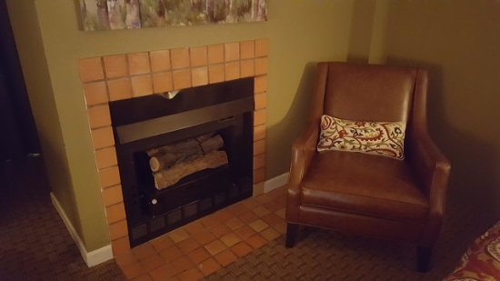 Angel Fire, NM: Fireplace next to the bed