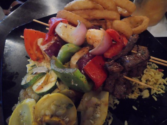 Riptides Raw Bar & Grill: kebabs with scallops, shrimp, steak, peppers, onions over yellow rice; grilled veggies, onion ri
