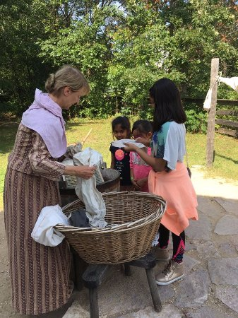 Eagle, WI: Actress in Irish Lady costume showing kids how the settlers used to wash clothes