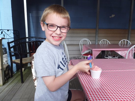 Vicksburg, MI : My grandson enjoying ice cream in their outdoor seating area.