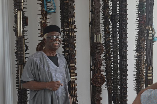 Lagos, Nigeria: Prof. Bruce Onobrakpeya in front of the famous installation of keys in Ovuomaroro Gallery