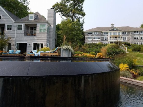 Lincolnville, ME: The rear view of infinity pool, the pool house and the main house, at the Inn at Oceans Edge
