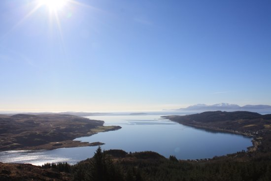 Tighnabruaich, UK: View from top of hill behind Tregortha with the village of Kames to the right and Arran beyond.