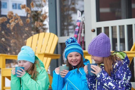 Thompsonville, MI: New friends sip hot cocoa at the Bungalows.