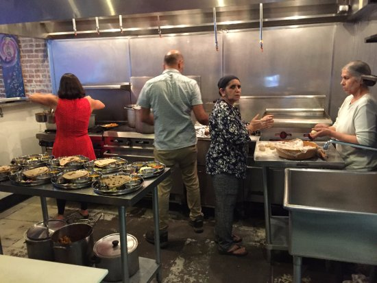 Family Members Making The Food At Thali