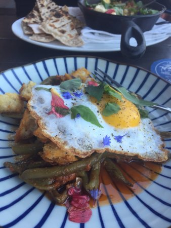 Misery Loves Company: A spin on a green bean casserole with sausage and fried egg