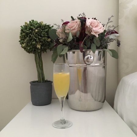 Ocean Beach, NY: Hubby was still sleeping while I worked on finishing the Champagne & keeping the bouquet alive!