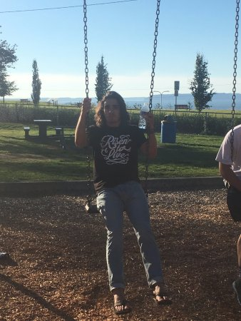 Everett, WA: Twins love to swing, last football team dinner.