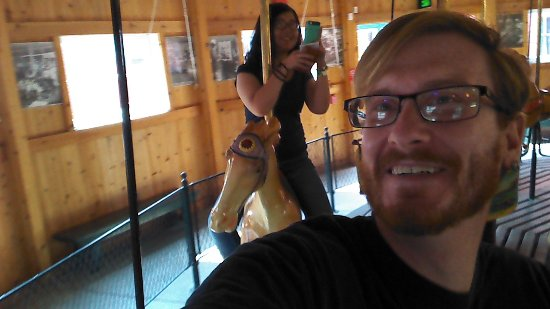 North Tonawanda, NY: My girlfriend and I, thoroughly enjoying ourselves on the carousel.