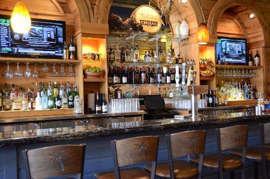 Hudson, WI: Cinderalla Blue granite bar with reclaimed wormy oak bar back