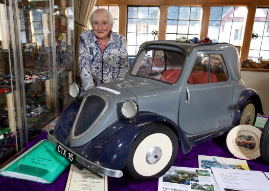 Montgomery, UK : Our patron Miss Gillian Rogers is pictured with a replica of a Fiat Topolino owned by her sister