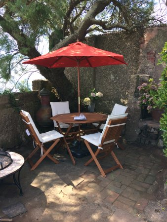 Budleigh Salterton, UK: A shady corner of the garden with stunning sea views