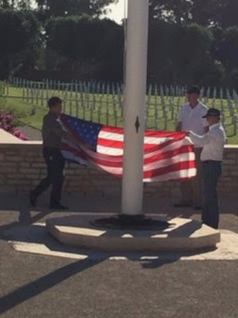North Africa American Cemetery and Memorial : Taking down the flag at the end of the day.