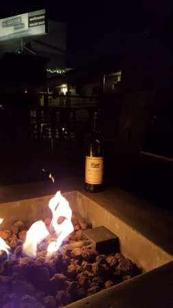 The Grove West Seattle Inn: enjoying a glass a wine by the fire pit