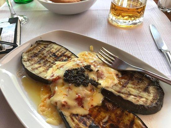 "Konoba Maslina: Sigh...local beer + POGACICE, fried bread: Don't miss it! In background, ""macaroni."""