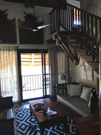Victoria Falls Safari Lodge: living area with steps to bedroom upstairs