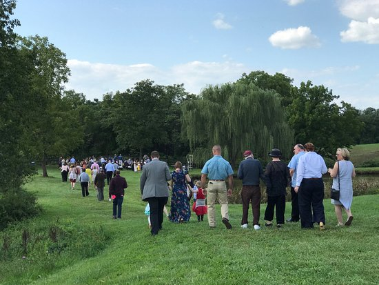 Leesburg, VA: wedding guests approach the ceremony site