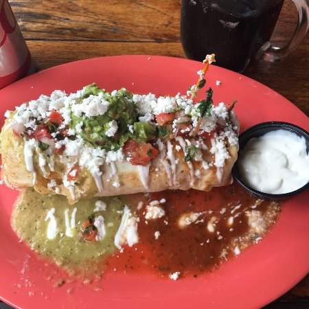 Tacos La Cantina: Tofu burrito with a side of sour cream. Sucks they charge $1.00 for about 2 tablespoons of sour
