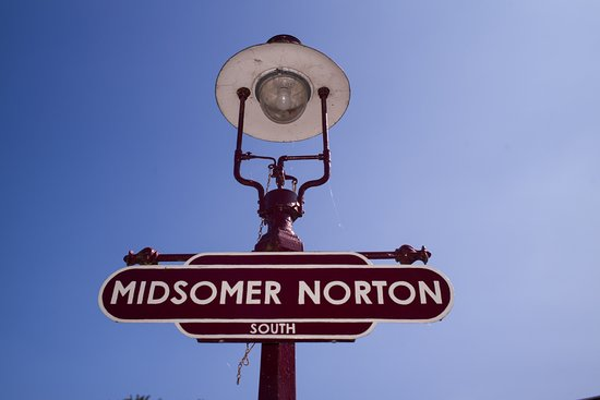Midsomer Norton, UK: A station lamp and BR totem sign