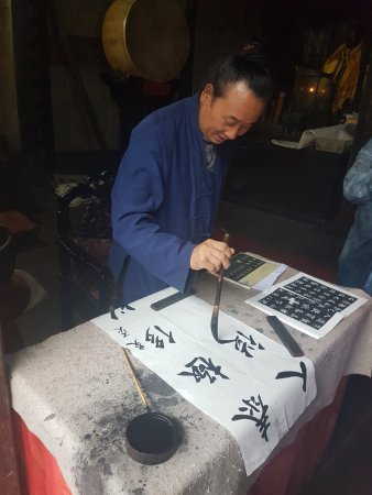 Danjiangkou, China: Toaist practicing his callagraphy