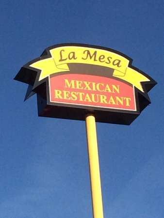 Council Bluffs, IA: Standing under the La Mesa Sign. It is located right off a busy road across the street fromshops