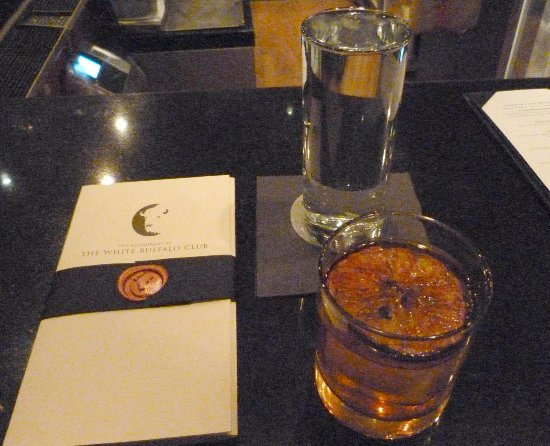 The Restaurant at White Buffalo Club: Special menu, Fashionable Scotch, glass of water at the bar