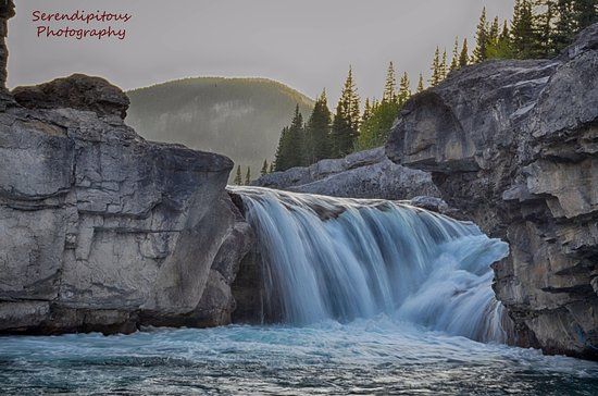 Bragg Creek, Canada: Standing knee deep in the cold water just before sunset