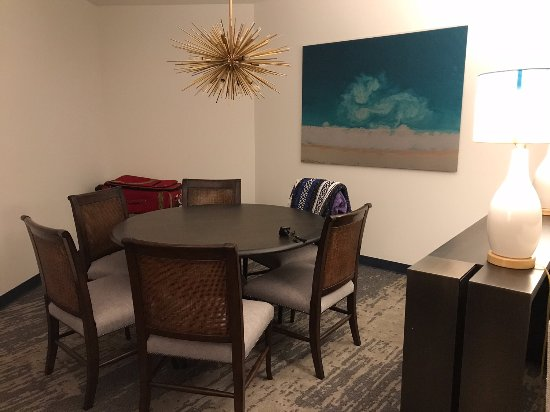 Large round dining table in living room area of Sapphire ...