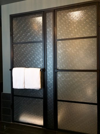 Shower And Water Closet Are Separated By These Doors Of Glass And